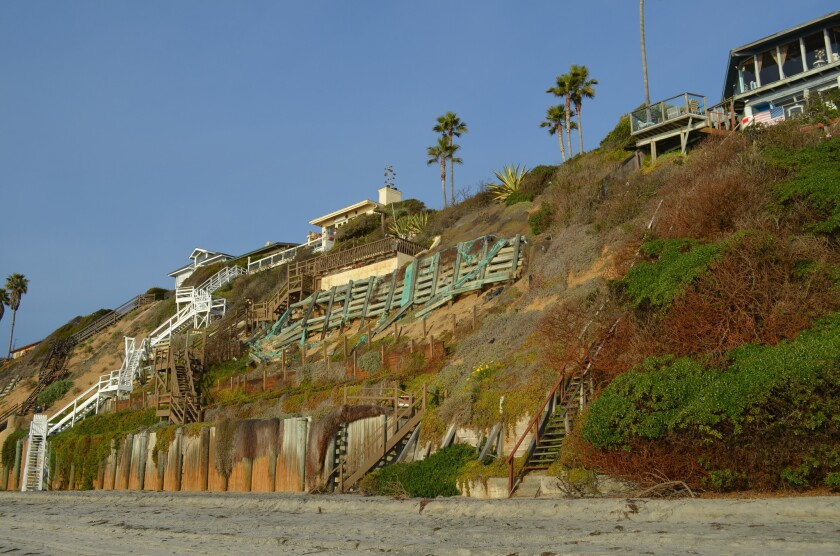 Encinitas homeowners are fighting the Coastal Commission in court over its demand that it reapply in 20 years for permission to keep the seawall that protects their property.
