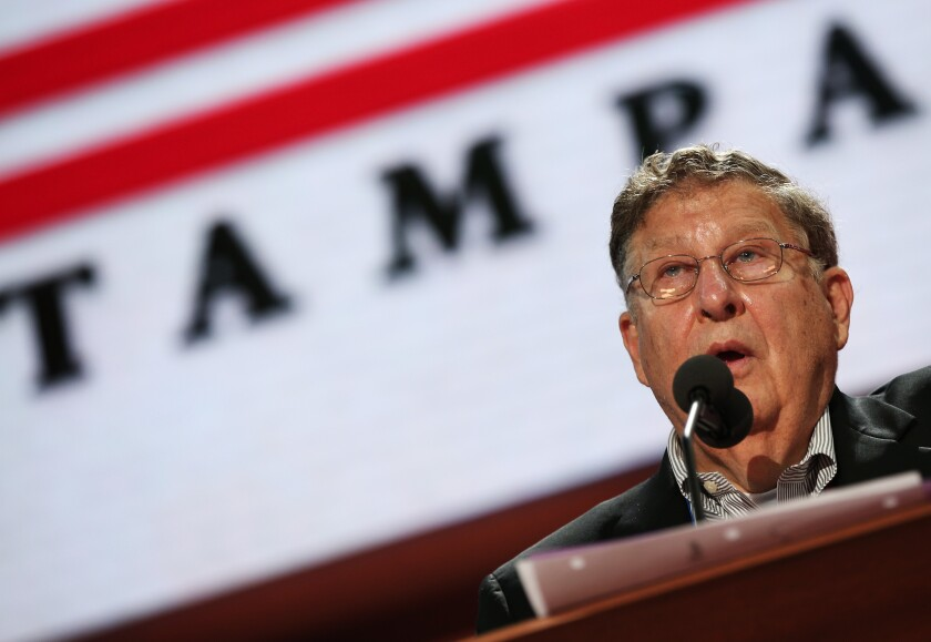 Former New Hampshire Gov. John Sununu stands at the podium on the abbreviated first day of the Republican National Convention in Tampa, Fla.
