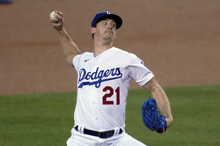 Dodgers right-hander Walker Buehler pitches to an Oakland Athletics batter during the first inning.