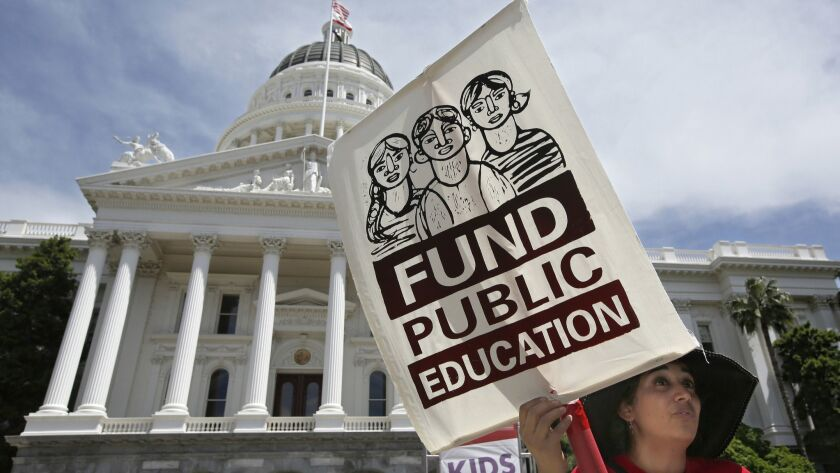 """Mayra Joseph, a teacher at Sylvia Mendez Elementary School in Berkeley, joins members of the California Teachers Assn. and supporters of public education in a march to the Capitol as part of """"RedForEd Day of Action"""" on Wednesday in Sacramento."""