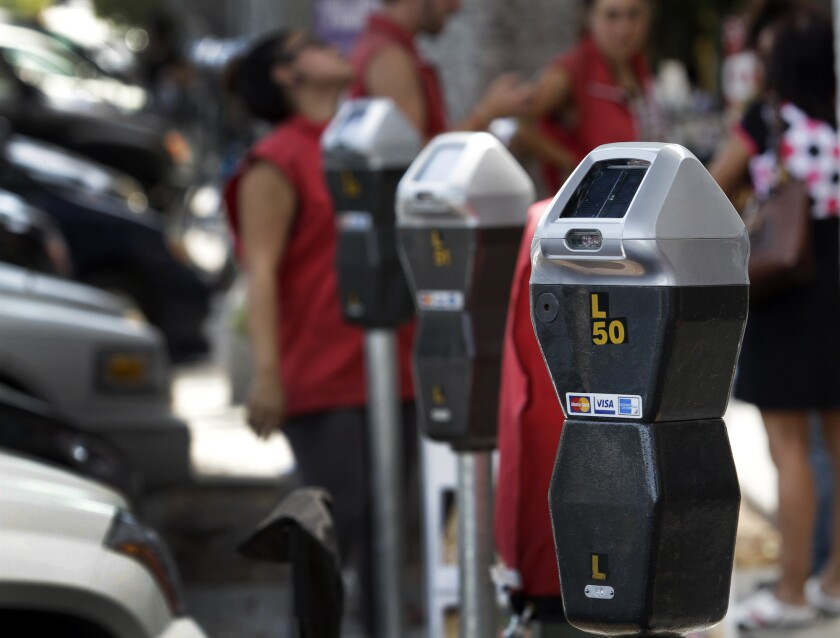 "A judge's tentative decision states that the city of Los Angeles must ""conduct the initial review"" of challenges to parking tickets and ""may not delegate that task"" to a processing agency."
