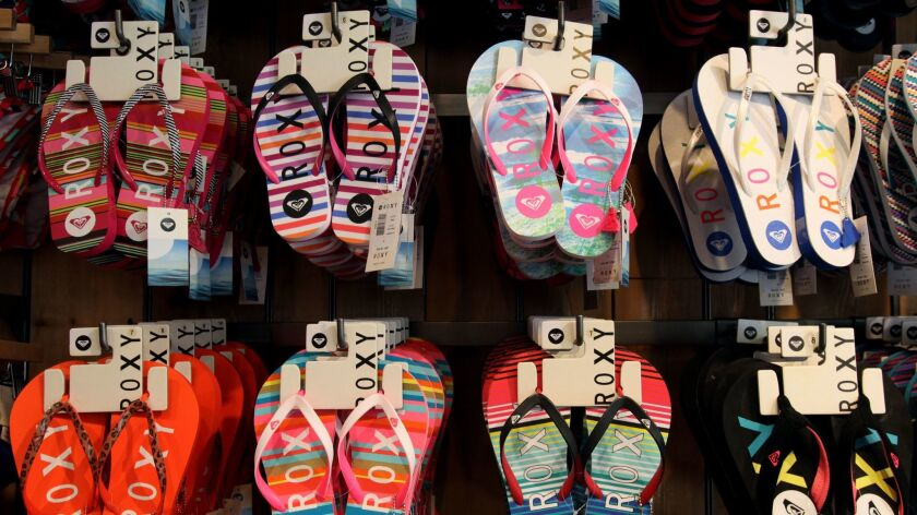Roxy sandals at Quiksilver on the Third Street Promenade in Santa Monica. Boardriders Inc., which owns the Roxy and Quiksilver brands, has agreed to acquire Billabong International Ltd.