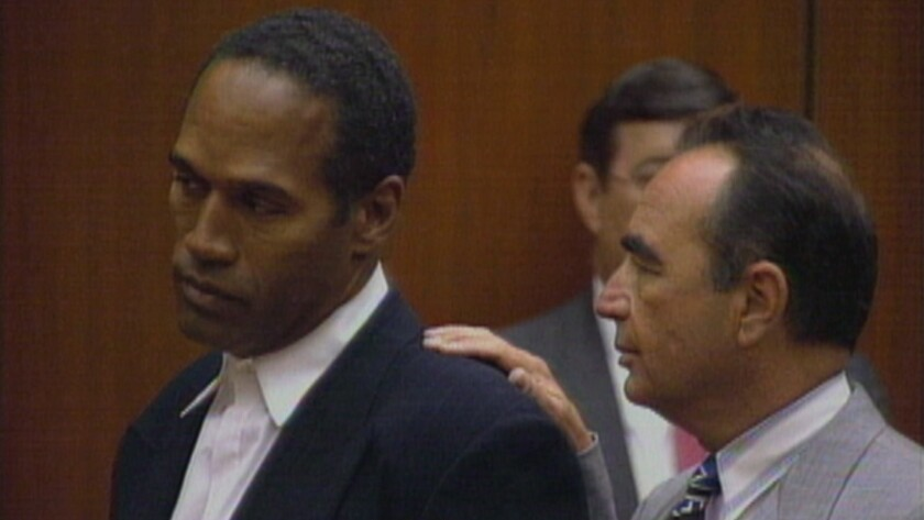 """O.J. Simpson and attorney Robert Shapiro in an image from """"O.J.: Made in America."""""""