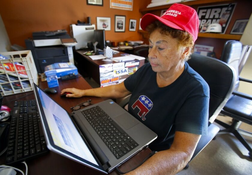 At the San Diego County Republican Party Headquarters in Rancho Bernardo, volunteer Jo Ann Cornelius of Clairemont sends out text message alerts to Republicans just three days before the November 8 election.
