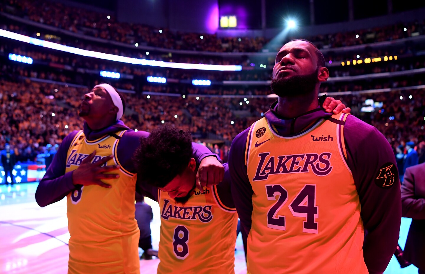 Kentavious Caldwell-Pope, Quinn Cook, and LeBron James close their eyes during a tribute to Kobe Bryant on Jan. 31 at Staples Center.