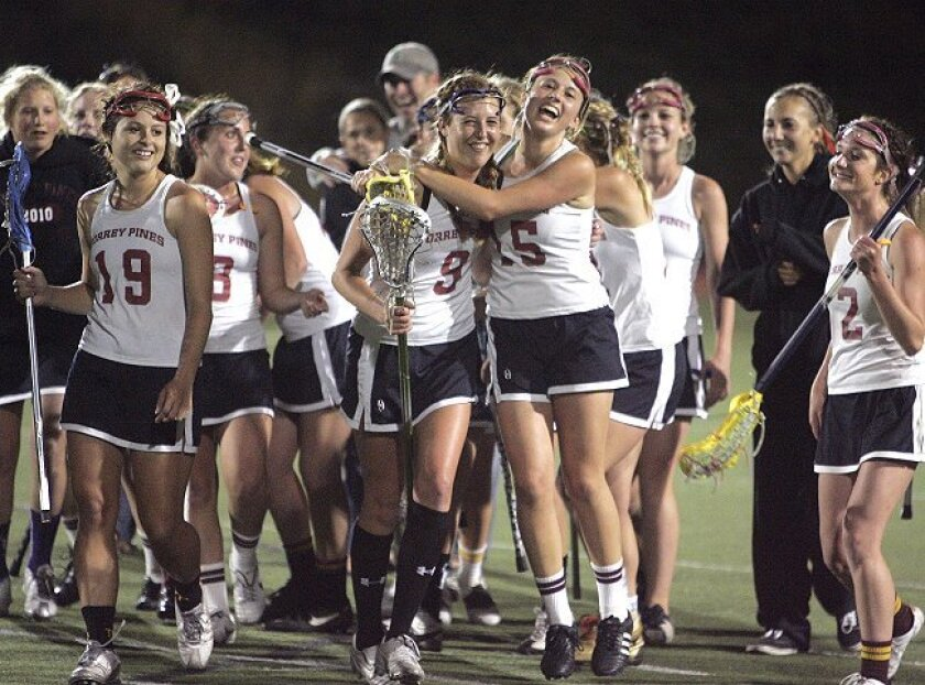 Jubilant Torrey Pines players celebrate their victory over Coronado Thursday night in the San Diego Section lacrosse championship.