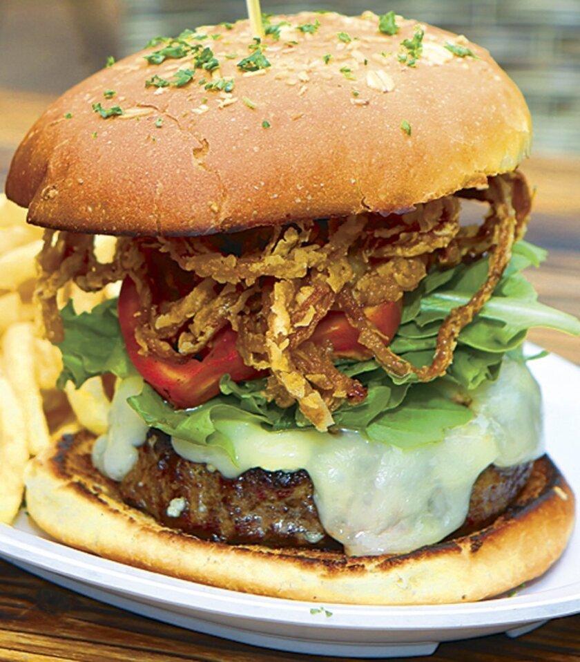 The hefty, 10-ounce Kobe Wagyu Burger at The Public House in La Jolla. Photo by Daniel K. Lew