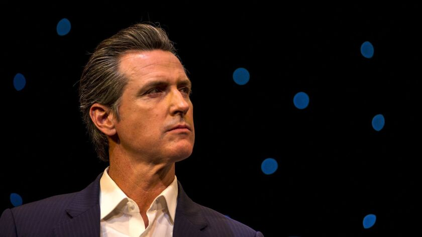 Gavin Newsom looks off to the side
