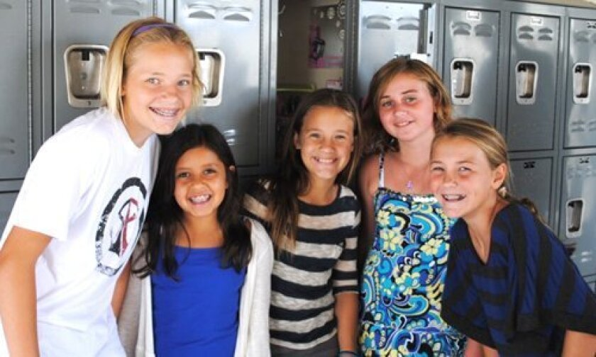 Checking out their new Middle School lockers, (L-R) Emma Albrecht, Gabrielle Dale, Madison Gilbert, Lea Palmer and Sydney Northbrook.