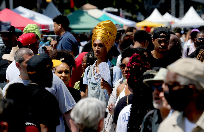 Crowds of people converge on Degnan Boulevard for a Juneteenth festival in Leimert Park on Saturday.