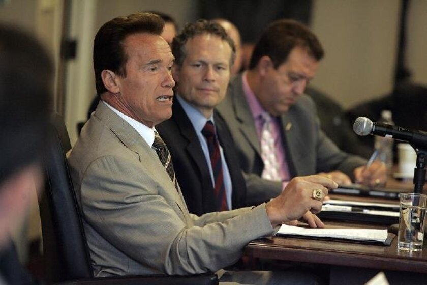 California Governor Arnold Schwarzenegger was in San Diego at the San Diego Regional Chamber of Commerce offices, downtown, on Thursday July 29, 2010 for a roundtable discussion on the budget impasse. To his right is Ruben Barrales, president of the Chamber, and Gary Gallegos, executive director of