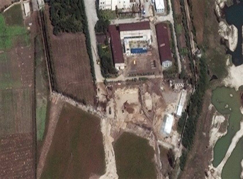 This satellite image provided by DigitalGlobe and taken Wednesday Sept. 29, 2010 shows the Yongbyon nuclear complex in Yongbyon, North Korea. The Washington-based Institute for Science and International Security released a report Sept. 30 stating that this satellite image shows new construction activity in the area surrounding the nuclear reactor at Yongbyon. The Institute for Science and International Security said satellite images showed heavy construction and excavation equipment and trucks at the Yongbyon site and construction of two small buildings near the site of the destroyed cooling tower. Under a 2007 deal, North Korea agreed to disable the complex in Yongbyon in return for 1 million tons of fuel oil and other concessions and in June 2008 even blew up its cooling tower. But disablement came to halt as Pyongyang wrangled with Washington over how to verify its past atomic activities. (AP Photo/DigitalGlobe) MANDATORY CREDIT; NO SALES