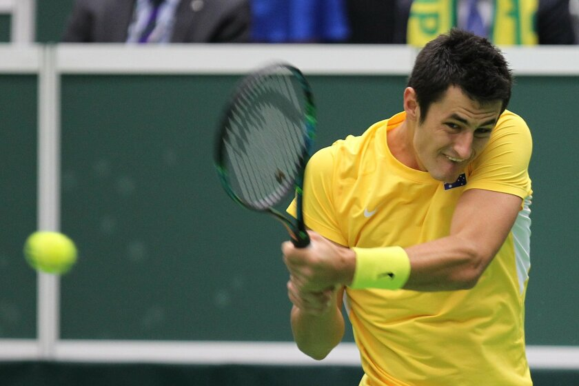 Bernard Tomic of Australia returns the ball  to Lukas Rosol of Czech Republic during their Davis Cup World Group first round tennis match between Czech Republic and Australia in Ostrava, Czech Republic, Sunday, March 8, 2015. (AP Photo/CTK, Petr Sznapka) SLOVAKIA OUT