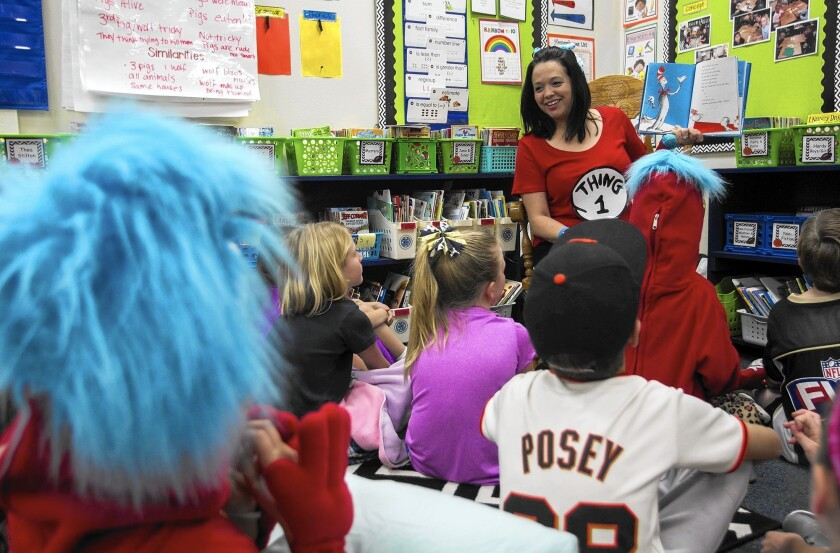 "Reggie Biancalini reads ""The Cat in the Hat"" book to Mariners Christian School students on March 2, 2016."