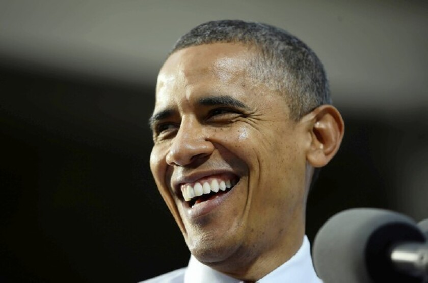 President Obama criticized Mitt Romney's record as governor of Massachusetts, while the Republican hailed his own record of bipartisanship.