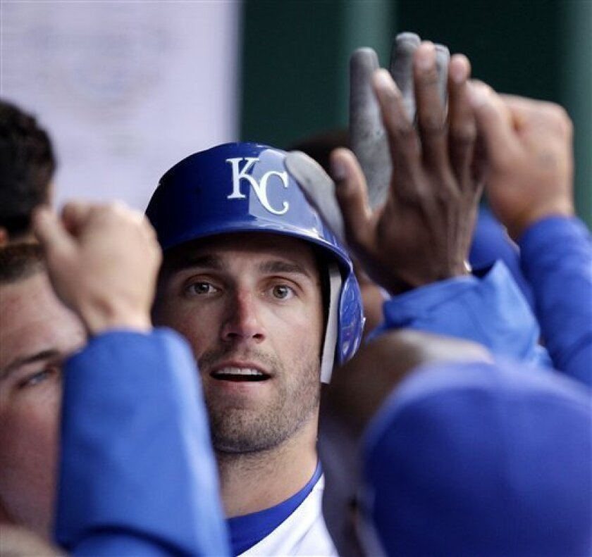Kansas City Royals' Jeff Francoeur celebrates in the dugout after hitting a home run during the seventh inning of an MLB baseball game against the Los Angeles Angels Thursday, March 31, 2011 in Kansas City, Mo. (AP Photo/Charlie Riedel)