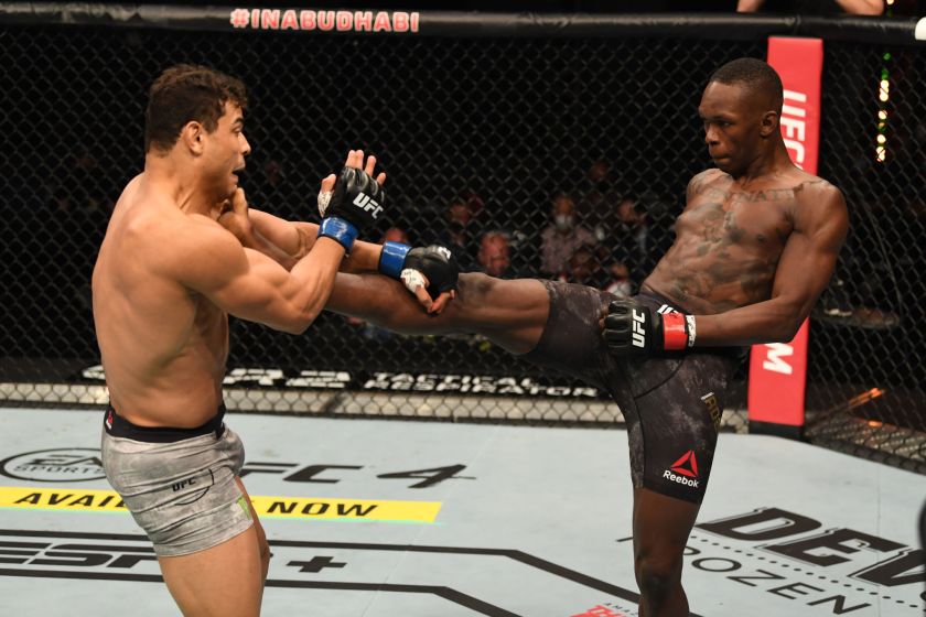 Israel Adesanya kicks Paulo Costa during their middleweight title bout at UFC 253 on Sunday.