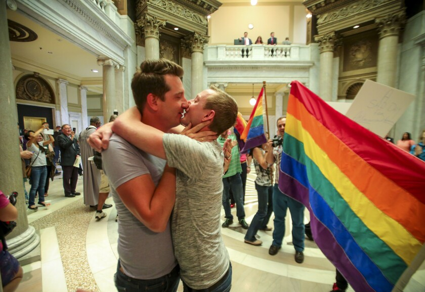 Brandon Armstrong, left, and Thomas Etheridge, both of Alexander, celebrate after being wed in the Pulaski County Courthouse in Little Rock, Ark., on May 12.