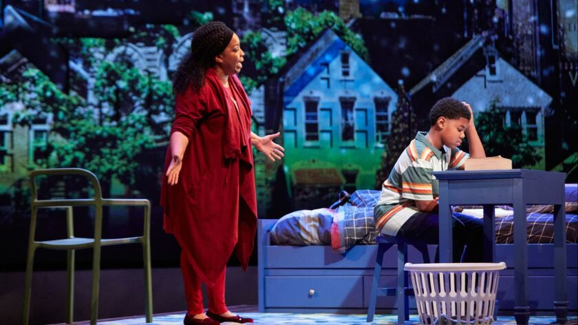 """Kimberly Hébert Gregory and Cedric Joe as mother and son in the world premiere of """"Black Super Hero Magic Mama"""" at the Geffen Playhouse."""