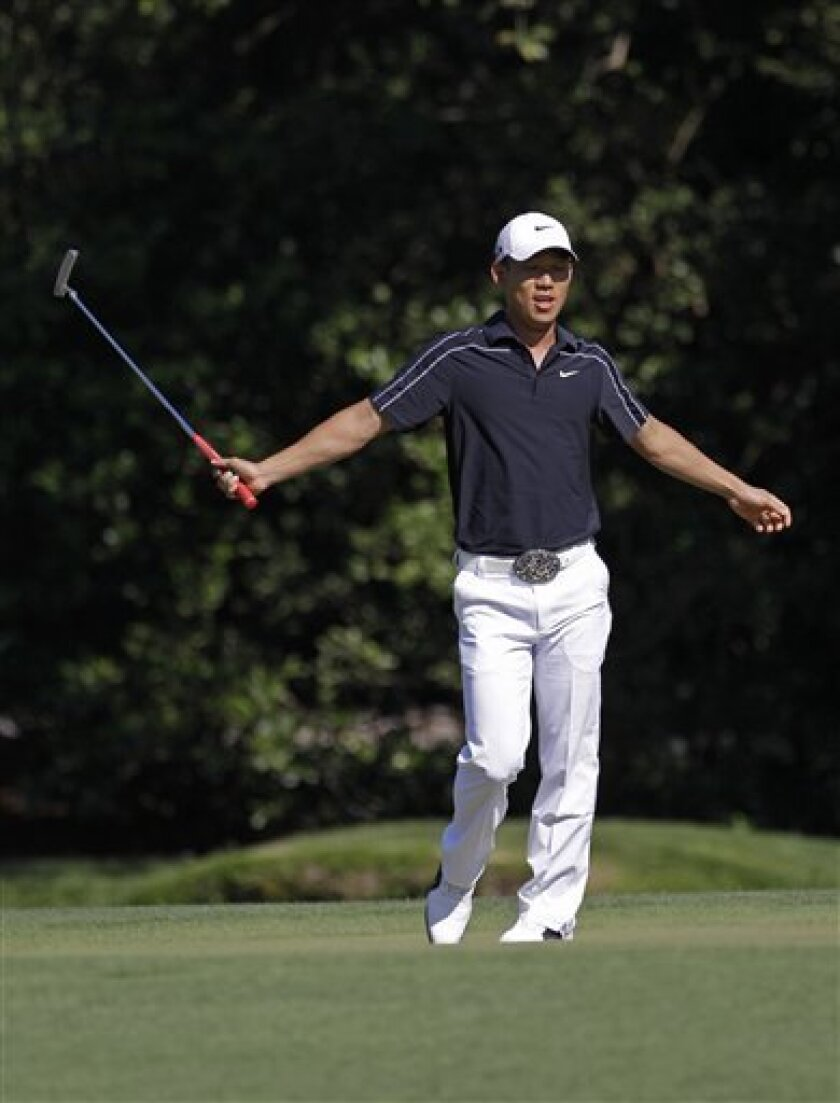 Anthony Kim reacts to a missed birdie putt on the 11th hole during the final round of the Masters golf tournament in Augusta, Ga., Sunday, April 11, 2010. (AP Photo/David J. Phillip)