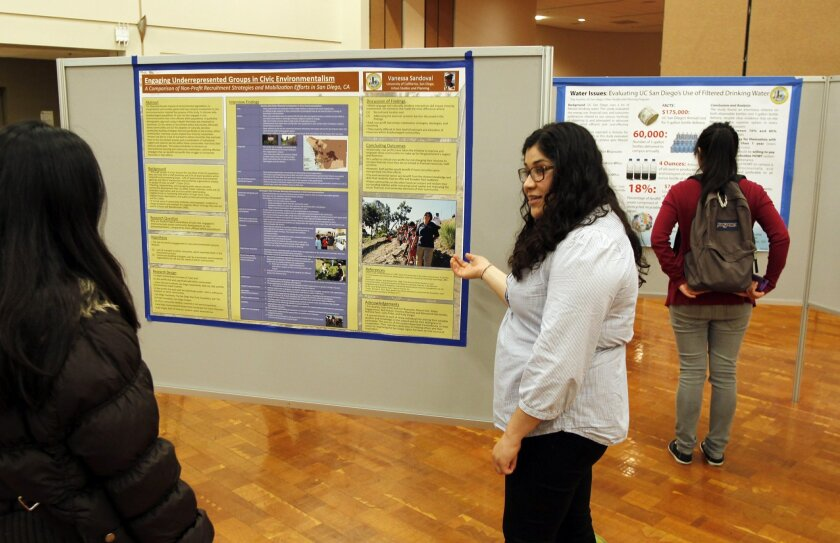 Vanessa Sandoval explains her project at the UCSD Urban Expo, where urban studies and planning students shared their research with friends, family and faculty.