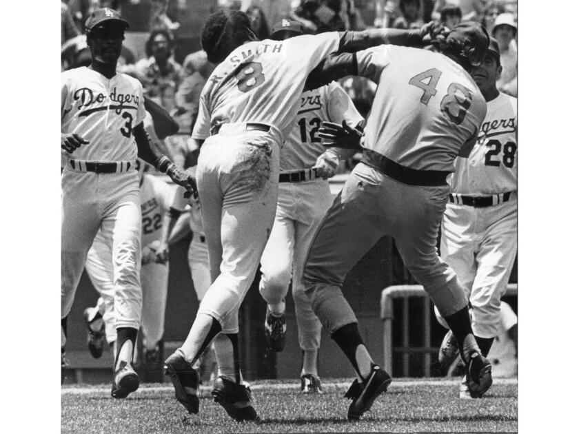 June 19, 1977: Dodgers Reggie Smith lands a punch on Chicago Cubs' pitcher Rick Reuschel after Reu