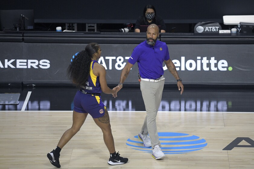 Sparks coach Derek Fisher greets guard Te'a Cooper during a timeout.