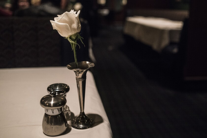 LOS ANGELES CA JUNE 22, 2018 -- White roses adorn the table at the Pacific Dining Car early Saturda