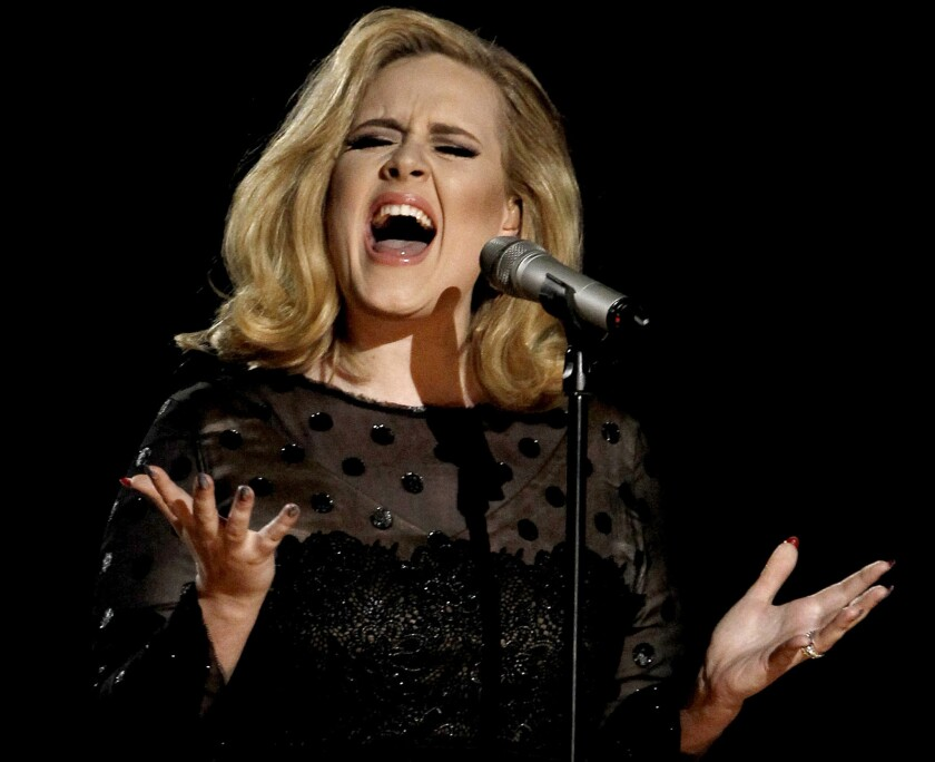 """Adele, shown performing at the 2012 Grammy Awards in Los Angeles, tweeted to fans that she will soon be releasing her third album, which she has titled """"25."""""""