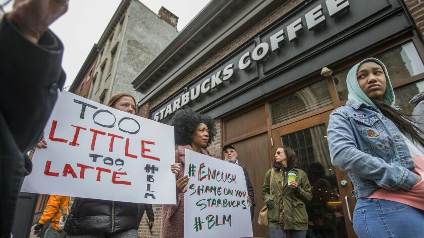 Protesters gather outside of a Starbucks in Philadelphia, Sunday, April 15, 2018, where two black m