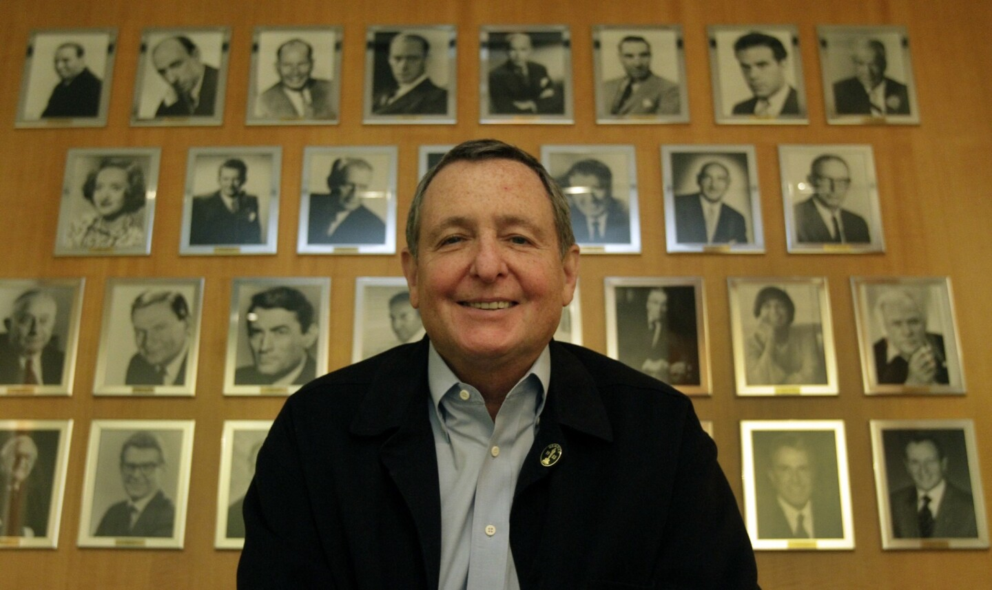"""Tom Sherak, who served in key posts at 20th Century Fox and was head of the Academy of Motion Picture Arts and Sciences from 2009 to 2012, has died at 68. Over his career, Sherak, who died after a long battle with prostate cancer, held high-ranking marketing and production jobs at Fox and eventually rose to chairman of the domestic film group. He was instrumental in movies such as """"Die Hard,"""" """"The Fly,"""" """"Wall Street"""" and """"Independence Day,"""" and at the time of his death had served as Los Angeles' film czar. In the above photo, Tom Sherak stands before a gallery of past presidents of the academy at its Beverly Hills headquarters on July 10, 2012, when he was the outgoing president of the academy."""
