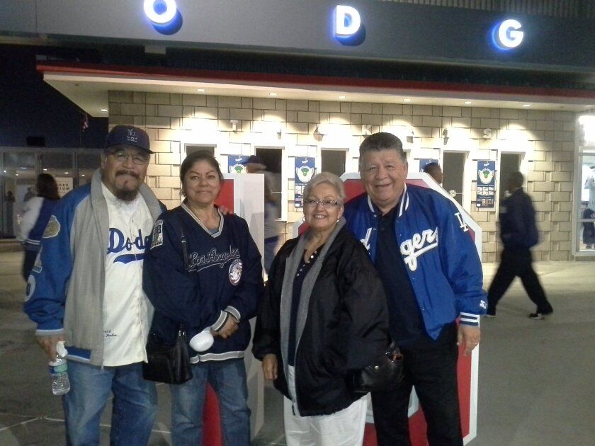 """Paul and Helen Martinez with brother Pete Martinez and wife Louise. His wife said she and Paul would watch Dodgers games on TV in their bedroom """"yelling, high fiving, just the two of us."""""""