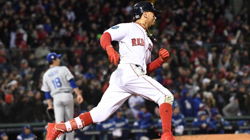 As Dodgers pitcher Kenta Maeda looks on, Mookie Betts hits a double for Boston in Game 2 of the 2018 World Series.