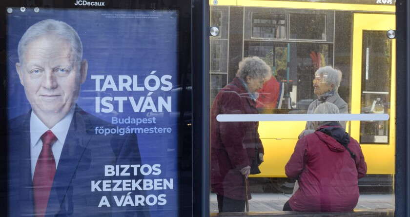 "In this picture taken on Tuesday, Oct. 8, 2019, a poster of Budapest Mayor Istvan Tarlos is displayed at a tram stop in Budapest, Hungary. Tarlos, backed by Prime Minister Viktor Orban's Fidesz party, is running for a third term. His main challenger is Gergely Karacsony, backed by several left-wing, liberal and green parties. The poster says ""The city in safe hands."" Hungary will hold nationwide municipal elections on Oct. 13. (AP Photo/Pablo Gorondi)"