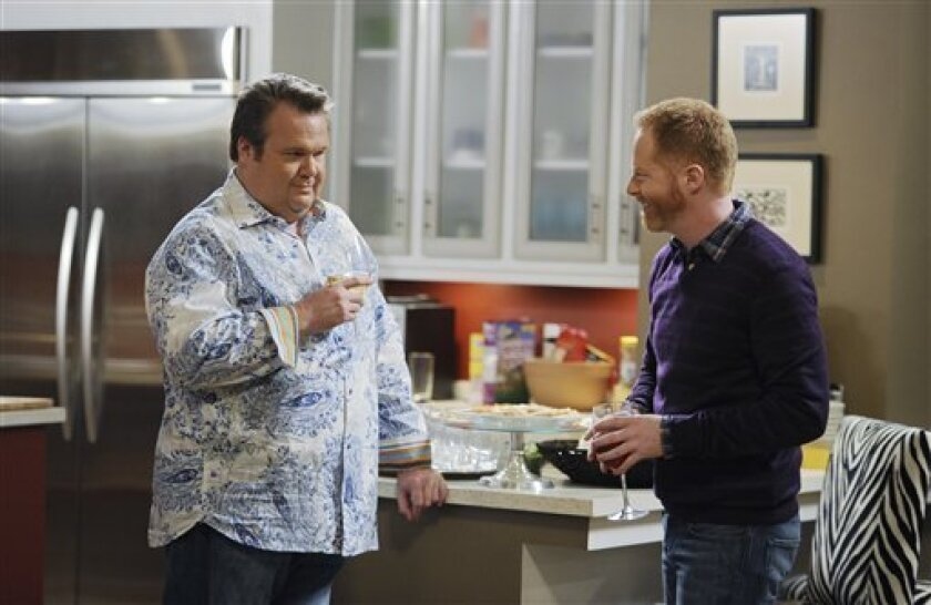 "In this publicity image released by ABC, Eric Stonestreet, left, and Jesse Tyler Ferguson are shown in a scene from ""Modern Family."" (AP Photo/ABC, Mitch Haddad)"
