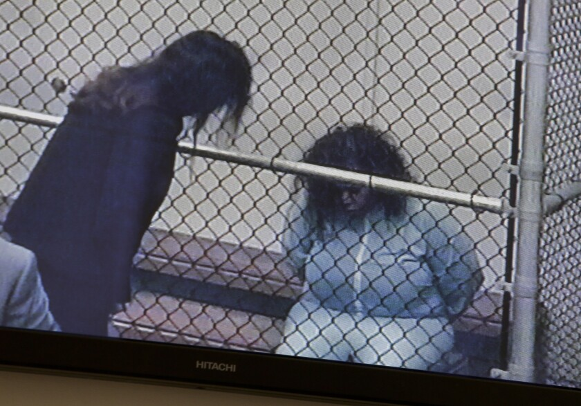 Marilyn Kay Edge, right, is shown on a monitor last month with an Orange County public defender.