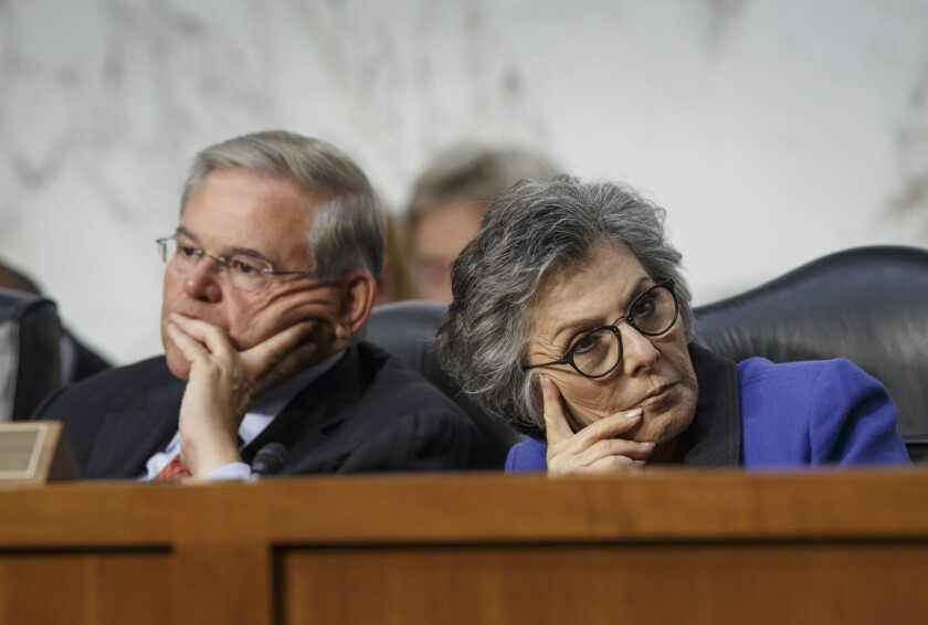 Senate Foreign Relations Chairman Robert Menendez (D-N.J.), left, and Sen. Barbara Boxer (D-Calif.) listen as Secretary of State John Kerry testifies on Capitol Hill about bolstering President Obama's strategy to combat Islamic State extremists.