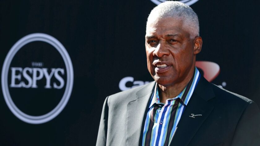 NBA legend Julius Erving arrives at the ESPY Awardsin July 2014. Erving fell ill at the Philadelphia 76ers' game on Friday and was taken to a hospital.