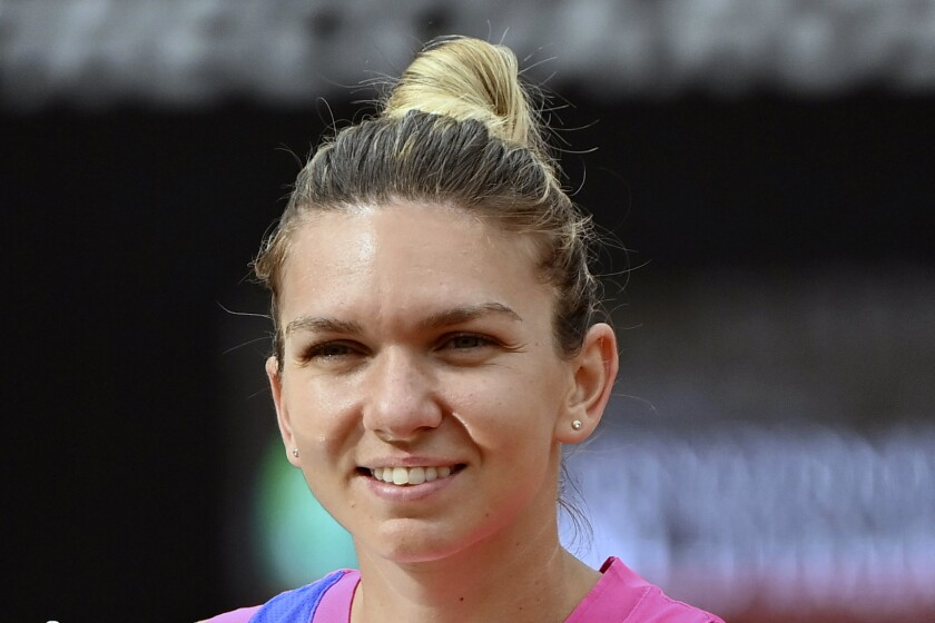 FILE - In this Monday, Sept. 21, 2020, file photo, Romania's Simona Halep poses after beating Czech Republic's Karolina Pliskova during their final match at the Italian Open tennis tournament in Rome. Halep is ranked second heading into the French Open. (Alfredo Falcone/LaPresse via AP, File)