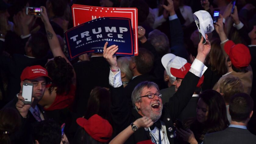 Supporters of Donald Trump cheer during his election night party in New York on Tuesday.