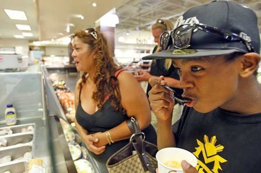 Maria Sinsay ordered a sandwich at Albertsons in East Village last week while her son Elijah Smith ate a cup of chicken noodle soup made at the grocery store. (K.C. Alfred / Union-Tribune)