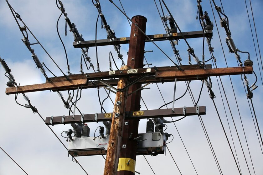 A wooden power pole