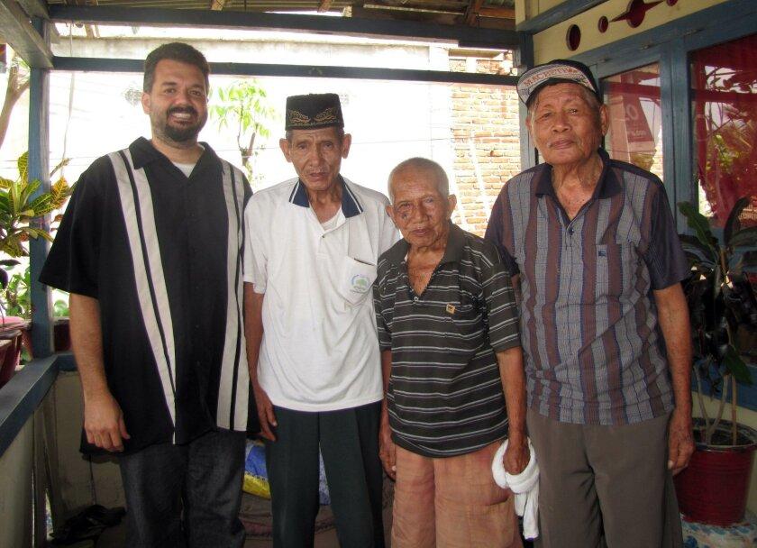 From left: Jason Lobel and Ponosakan speakers Kader Tawo, Ibrahim Tona and Asri Abraham. Courtesy photo