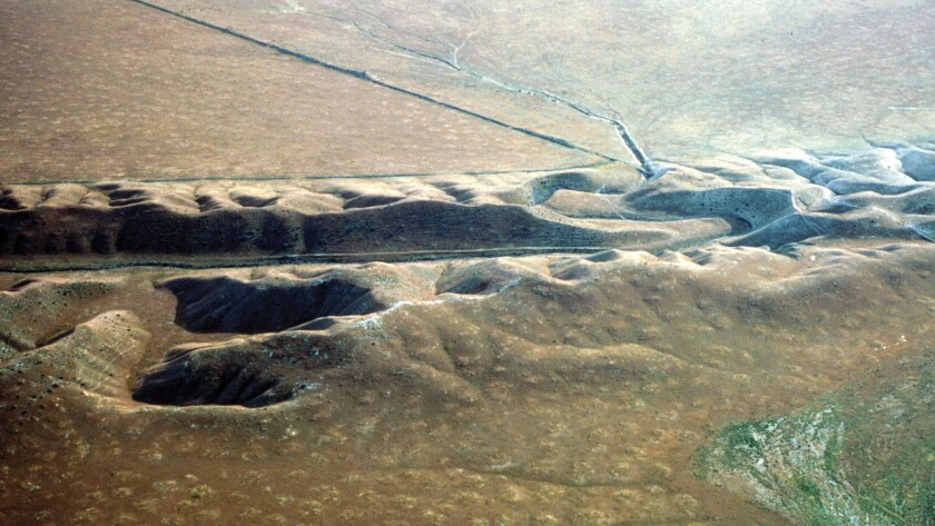 A photo shows a valley eroded along the San Andreas fault in the Carrizo Plain.