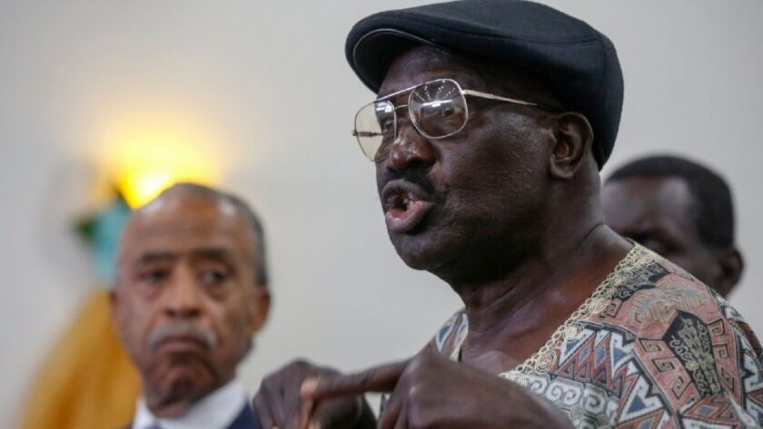 Richard Olango, whose son was killed by El Cajon police in September, spoke at a South Los Angeles news conference in October. Olango filed a lawsuit against police on Tuesday.