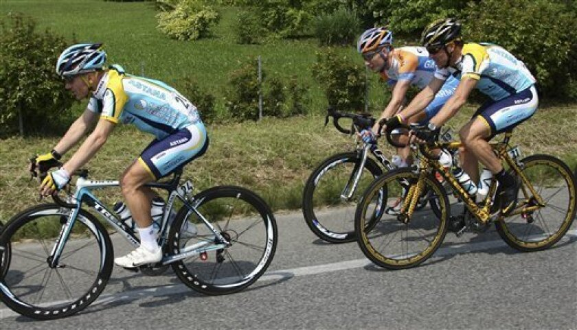 American cyclist Levi Leipheimer leads his fellow-countrymen Lance Armstrong, foreground, and David Zabriskie during the third stage of the Giro d'Italia, Tour of Italy cycling race, from Grado to Valdobbiadene, Monday, May 11, 2009. (AP Photo/Alessandro Trovati)
