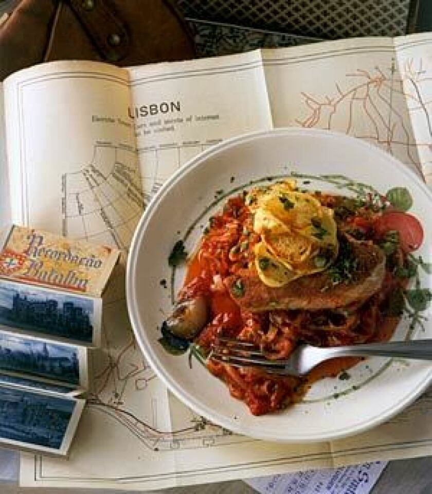 "FOOD FOR THOUGHT: Fried tuna with tomatoes and onions is one of the dishes in ""Piri Piri Starfish: Portugal Found"" by Tessa Kiros, who spent a year in Portugal exploring its cuisine. The result is as much journal and travelogue as cookbook"