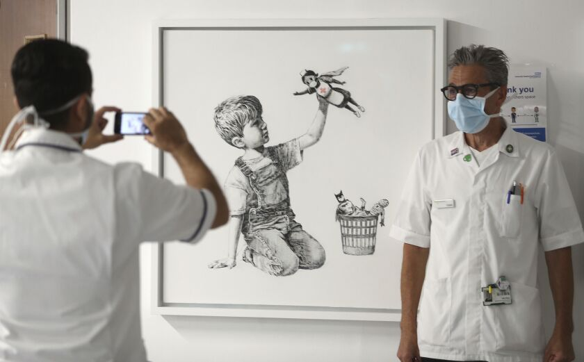 Banksy's new painting, in honor of Britain's healthcare workers, has gone on display in a hospital in Southampton, England.