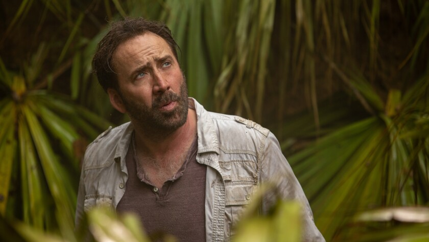 "A bearded Nicolas Cage in a jungle setting in ""Primal."""