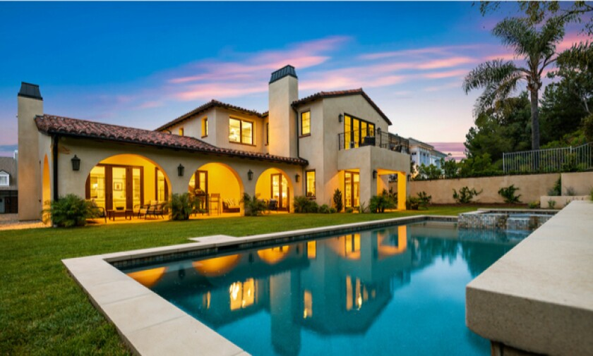 Built in 2019, the two-story home features Spanish style on the outside and bright, modern living spaces inside.
